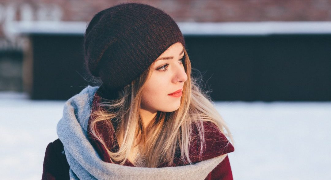 woman on snowy day in black stocking hat
